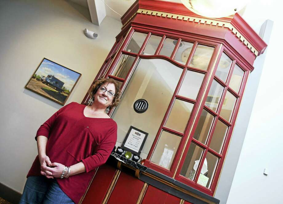 Paige Miglio, executive director of the Milford Arts Council, is photographed in front of the former box office of the Capitol Theatre that now serves as the ticket office for the Milford Art Council at the Milford Arts Council Building. Photo: Arnold Gold — New Haven Register