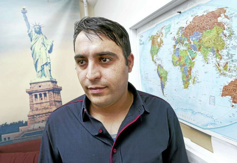 Hewad Jhan Hemat of Afghanistan is photographed at Integrated Refugee and Immigrant Services in New Haven on Friday. Photo: Arnold Gold — New Haven Register