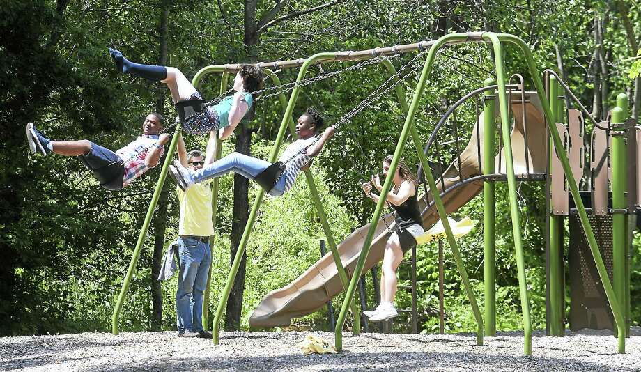 (Arnold Gold/Hearst Connecticut Media)  People take advantage of a swing set during the GRO1000 dedication ceremony for Cherry Ann Park in New Haven on 6/10/2017.  The Scotts Miracle-Gro Foundation donated $40,000 for the park. Photo: Digital First Media