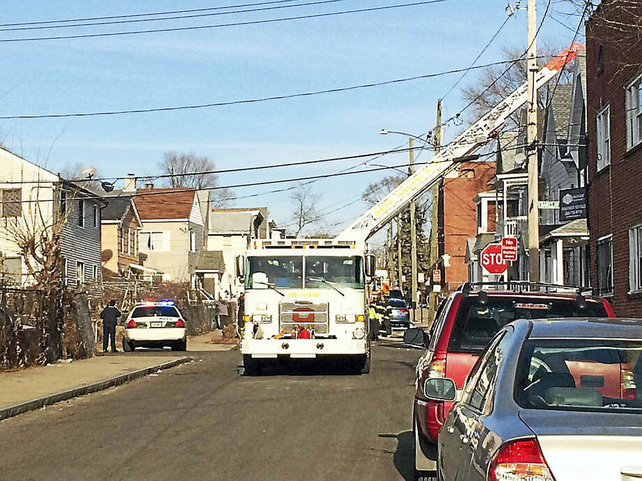Fire crews respond to a fire on Frank Street on Monday afternoon. Photo: Wes Duplantier — New Haven Register