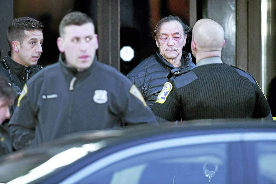 Norm Clements, second from right, is detained by New Haven and Connecticut State Police on Chapel Street following a protest against federal immigration policy that temporarily closed Route 34 northbound in New Haven on Saturday. Photo: Arnold Gold — New Haven Register