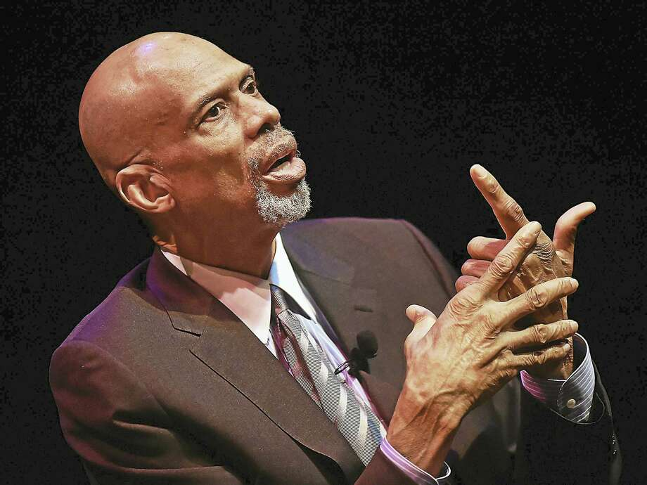 NBA legend Kareem Abdul-Jabbar is interviewed by political sportswriter Dave Zirin as part of the the Mary and Louis Fusco Distinguished Lecture Series Friday at the John Lyman Center for Performing Arts at Southern Connecticut State University in New Haven. Photo: Catherine Avalone — New Haven Register   / Catherine Avalone/New Haven Register