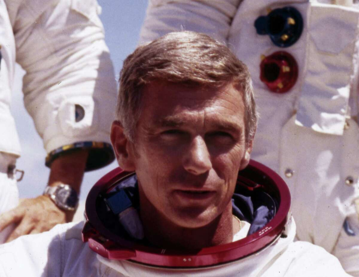 FILE - In an undated file photo provided by NASA, US Navy Commander and Astronaut for the upcoming Apollo 17, Eugene Cernan, is pictured in his space suit. NASA announced that former astronaut Cernan, the last man to walk on the moon, died Monday, Jan. 16, 2017, surrounded by his family. He was 82.