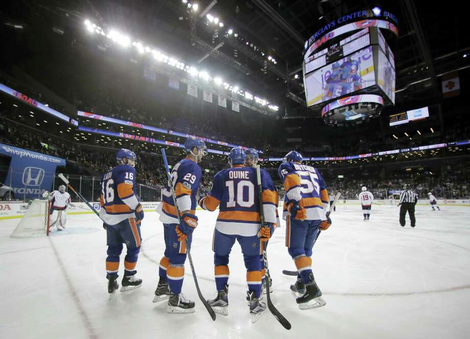 Members of the New York Islanders huddle up during a recent game. Photo: The Associated Press File Photo   / Copyright 2017 The Associated Press. All rights reserved.