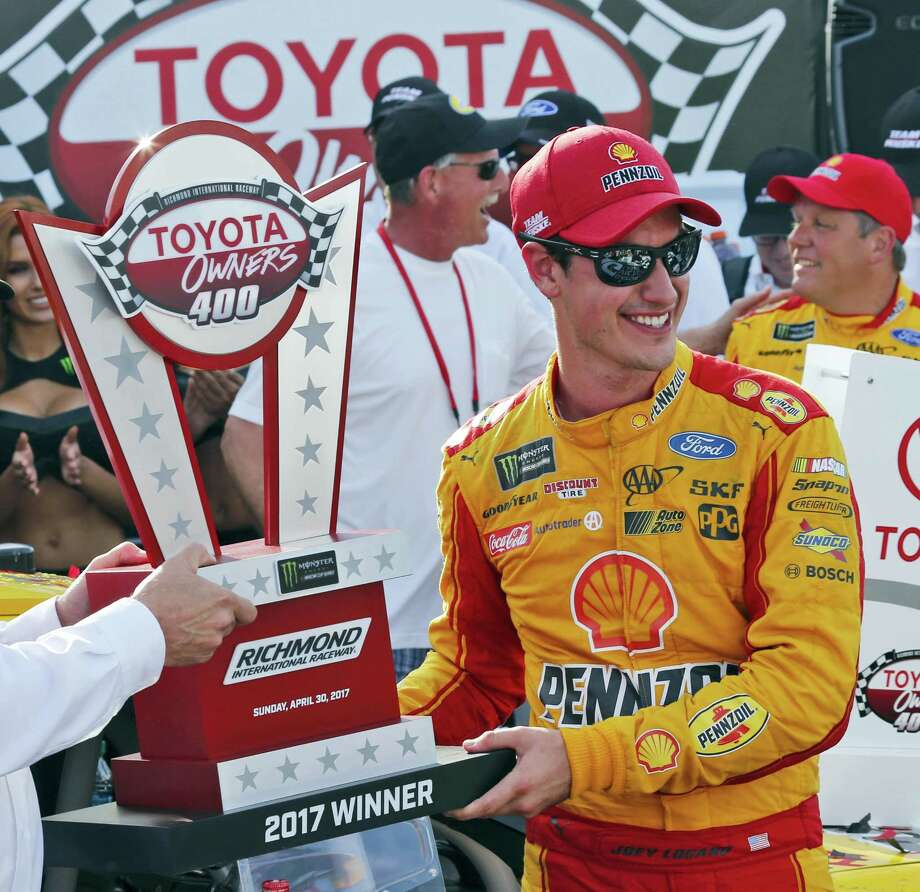 Joey Logano celebrates after winning the NASCAR Cup Series auto race with the winners trophy in Victory Lane at Richmond International Raceway in Richmond, Va. on April 30, 2017. Photo: AP Photo — Steve Helber   / Copyright 2017 The Associated Press. All rights reserved.