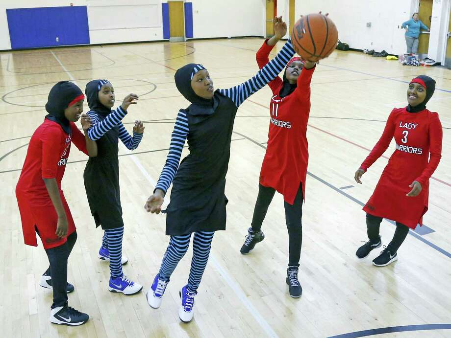 In this June 16, 2015 photo, East African Muslim girls practice basketball in their new uniforms in Minneapolis. Members of basketball's international governing body are expected to vote to eliminate a rule that bans religious headgear during competition. Headgear was banned for safety reasons two decades ago out of fear it could fall off, causing a player to slip or become entangled. Photo: AP Photo — Jim Mone, File   / Copyright 2017 The Associated Press. All rights reserved.
