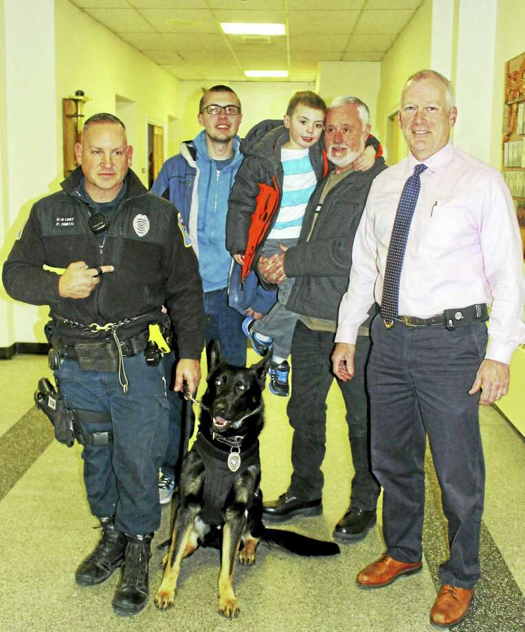 From left, Ansonia police Officer Paul Smith with police dog Kane, David Shepherd Jr., David Shepherd holding grandson Jimmy Shepherd, and Police Chief Kevin Hale. Photo: Jean Falbo-Sosnovich — New Haven Register