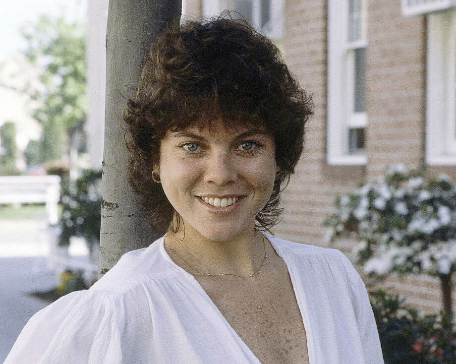 """This Feb. 19, 1982, file photo shows actress Erin Moran of the television show, """"Happy Days"""" in Los Angeles. A photo shared online on May 3, 2017, shows the cast of """"Happy Days"""" briefly reunited at a memorial service for Moran, who died at her Indiana home last month. Photo: AP Photo/Wally Fong, File    / AP1982"""