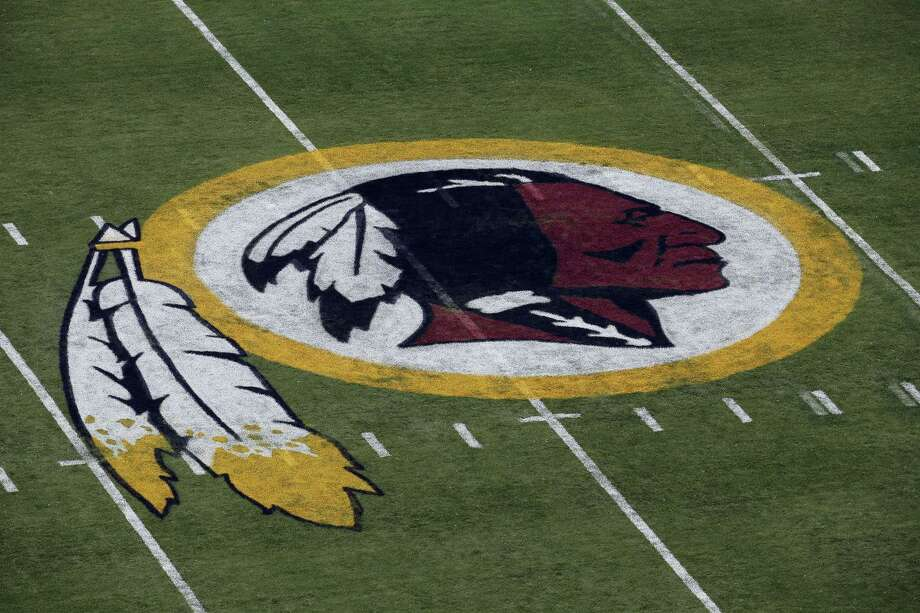 In this Aug. 7, 2014 photo, the Washington Redskins logo is seen on the field before an NFL football preseason game against the New England Patriots in Landover, Md. A First Amendment fight will play out Wednesday, Jan. 18, 2017 in the Supreme Court, as the justices consider whether a law barring disparaging trademarks violates free speech rights. Photo: AP Photo/Alex Brandon, File   / Copyright 2017 The Associated Press. All rights reserved.