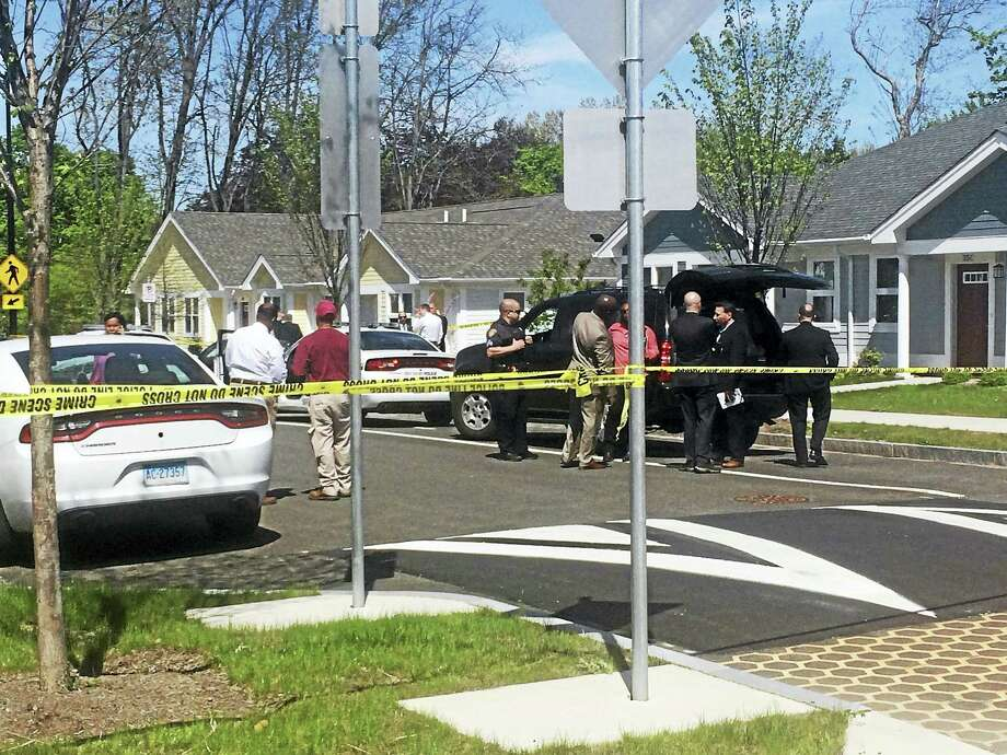 Police were investigating after a body was found Thursday at the Brookside housing complex. Photo: Jessica Lerner — New Haven Register