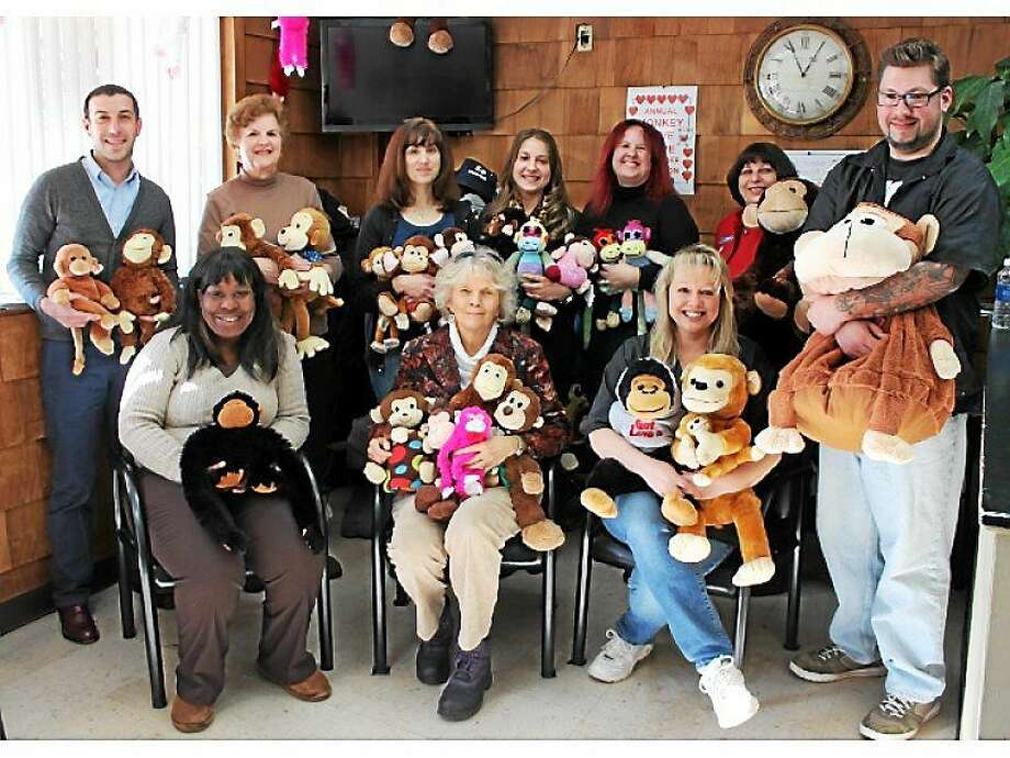 Valley nonprofit agency representatives pose with some of the stuffed simians they will be giving to clients for Valentine's Day, thanks to the eighth annual Monkey Love Drive. Photo: Patricia Villers/Register File Photo