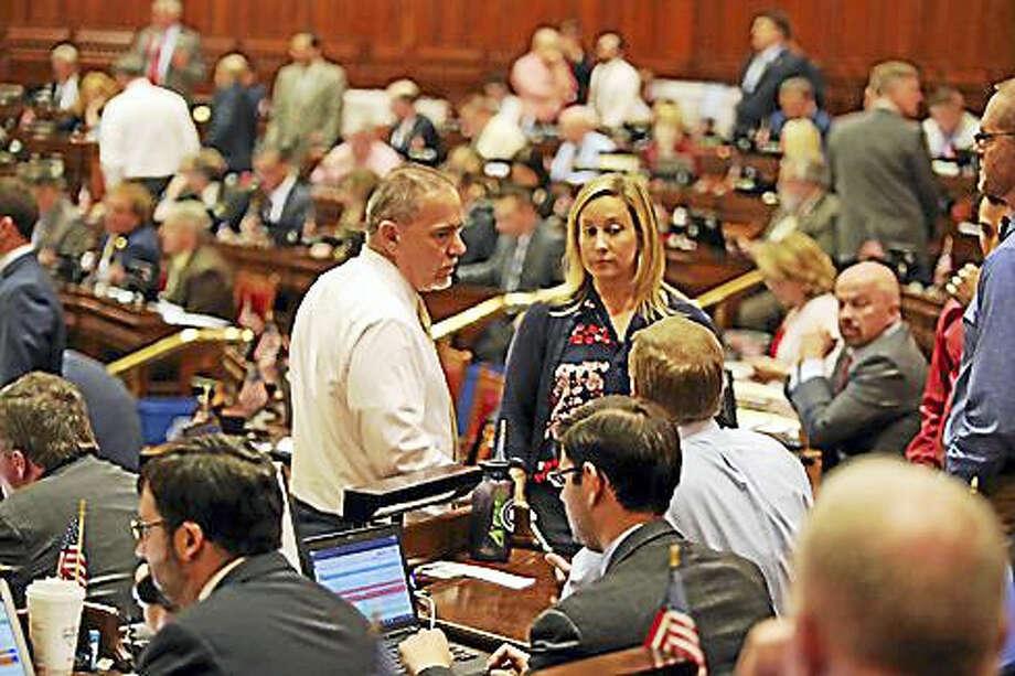 Speaker Joe Aresimowicz and Rep. Liz Linehan, D-Cheshire, chat with Majority Leader Matt Ritter in the House. Photo: Christine Stuart — CTNewsJunkie