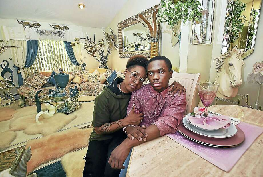 Jacquis Hornesburger, 24, with his sister, Deneisha Coles, 30, of East Haven at their parents Hamden home. Photo: Catherine Avalone — New Haven Register    / Catherine Avalone/New Haven Register