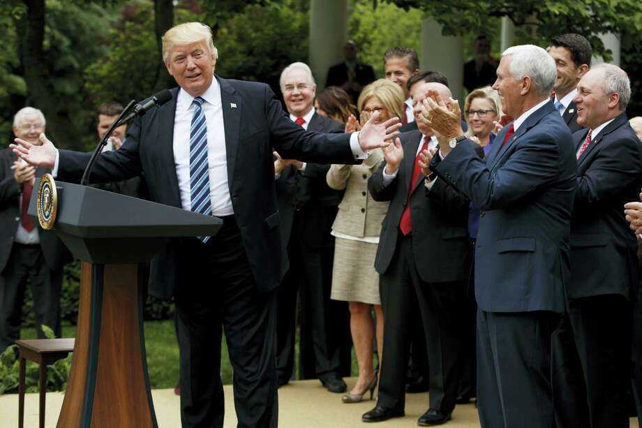 President Donald Trump, accompanied by GOP House members, speaks in the Rose Garden of the White House in Washington Thursday after the House pushed through a health care bill. Photo: Evan Vucci — The Associated Press   / Copyright 2017 The Associated Press. All rights reserved.
