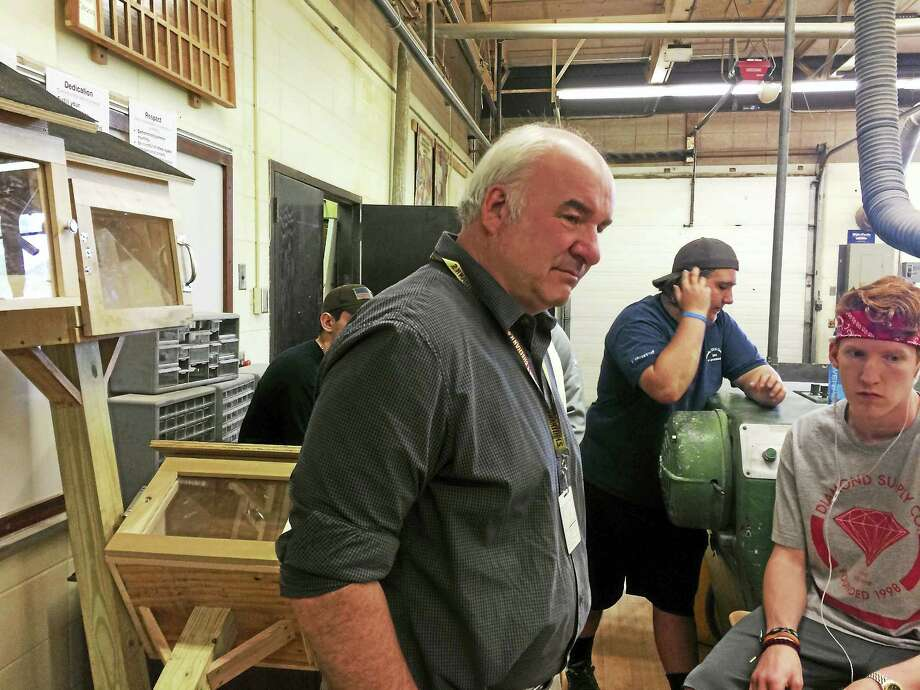 Technology education teacher Alan Oblon, who is retiring after 38 years, meets with some of the students who helped build the book exchange boxes. Photo: LUTHER TURMELLE — NEW HAVEN REGISTER