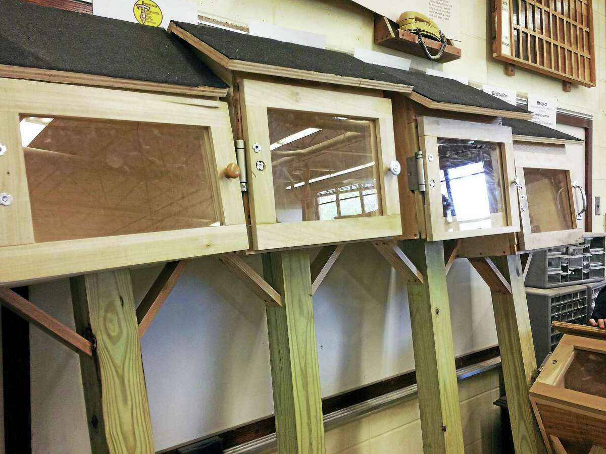 Four unfinished book exchange boxes line the wall in the technical education classroom at Mark T. Sheehan High School in Wallingford.