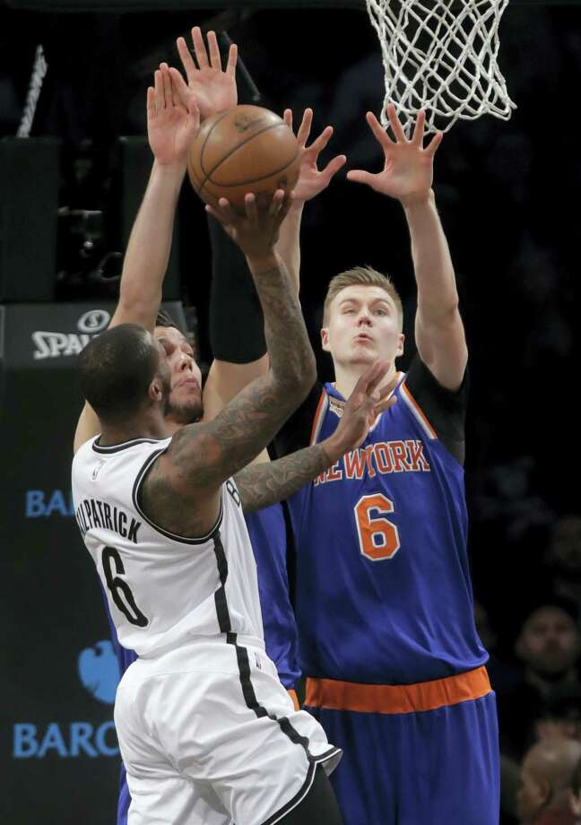 New York Knicks' Kristaps Porzingis (6), and teammate Willy Hernangomez defend as Brooklyn Nets' Sean Kilpatrick (6) Wednesday in New York. Photo: Frank Franklin II — The Associated Press   / Copyright 2017 The Associated Press. All rights reserved.