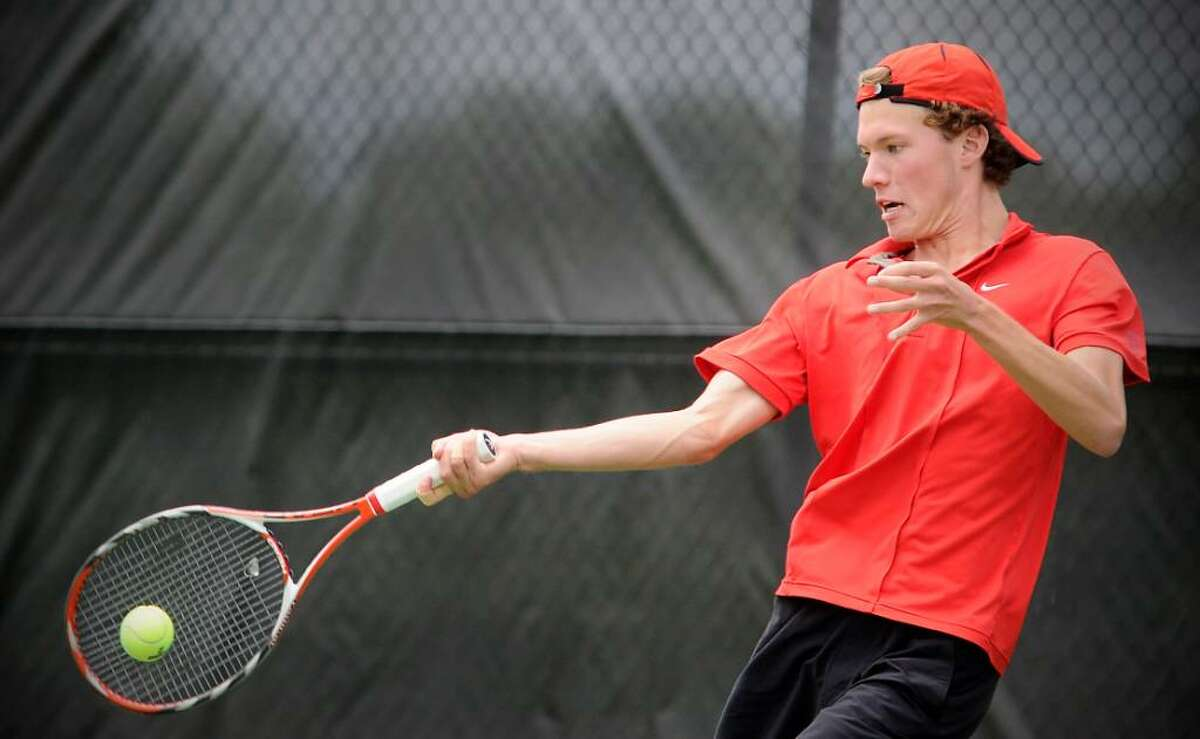 New Canaan's Ben Lee returns a shot during the singles match in the Class L state finals in boys tennis in New Canaan Conn. on Friday June 11, 2010.
