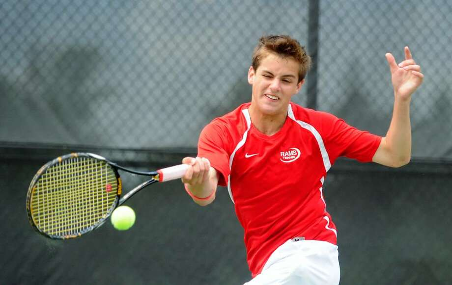 New Canaan's Nick Laub returns a shot during the doubles finals in the  Class L state championship in boys tennis in New Canaan Conn. on Friday June 11, 2010. Photo: Kathleen O'Rourke / Stamford Advocate