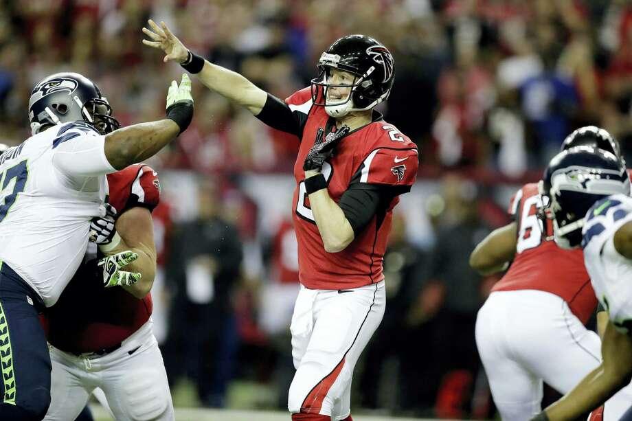 Falcons quarterback Matt Ryan (2) works against the Seahawks during the first half Saturday. Photo: David Goldman — The Associated Press   / Copyright 2017 The Associated Press. All rights reserved.