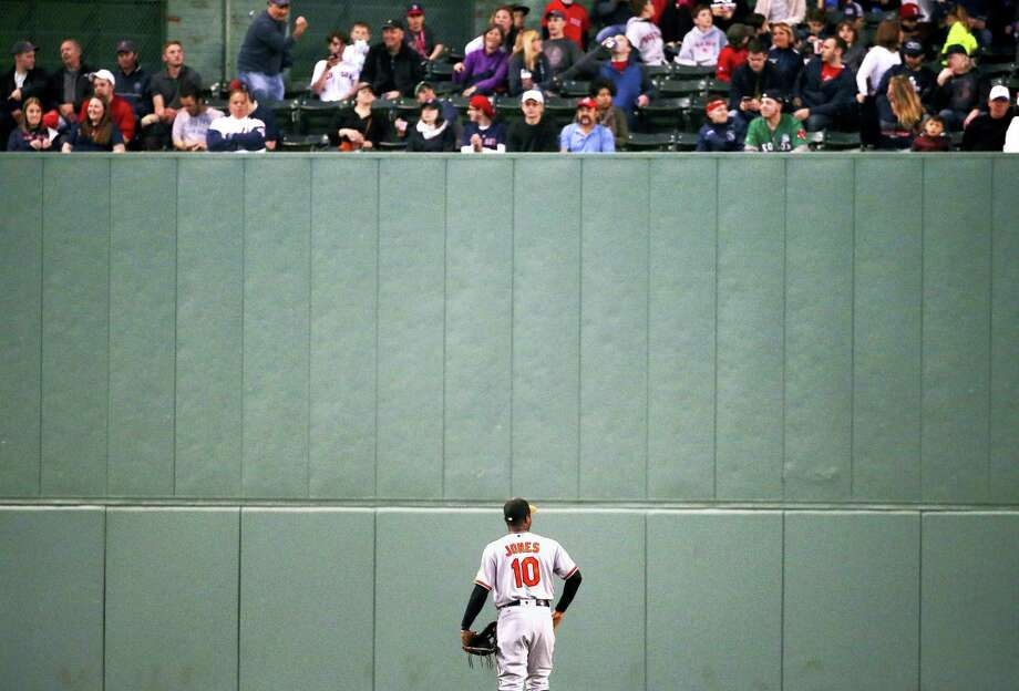 Baltimore Orioles' Adam Jones looks up at fans in center field during the third inning of a baseball game against the Boston Red Sox on May 2, 2017 in Boston. Photo: AP Photo — Michael Dwyer   / Copyright 2017 The Associated Press. All rights reserved.