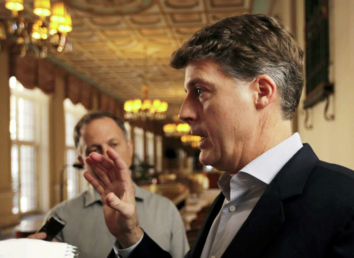 New York Yankees owner Hal Steinbrenner talks with reporters following a meeting with MLB owners on Thursday in Palm Beach, Fla.