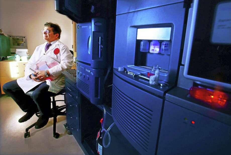 Professor Vasilis Vasiliou of the Yale School of Public Health, in the mass spectrometry and metabolomics lab at the school. Photo: Peter Hvizdak — New Haven Register   / ©2016 Peter Hvizdak