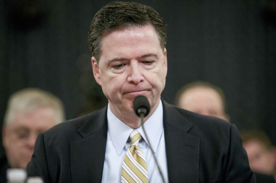 "In this file photo, then-FBI Director James Comey pauses as he testifies on Capitol Hill in Washington, before the House Intelligence Committee hearing on allegations of Russian interference in the 2016 U.S. presidential election. Comey will testify that President Donald Trump sought his ""loyalty"" and asked what could be done to ""lift the cloud"" of investigation shadowing his White House, according to prepared remarks released ahead of his appearance on Capitol Hill on. Photo: J. Scott Applewhite — The Associated Press File   / AP"