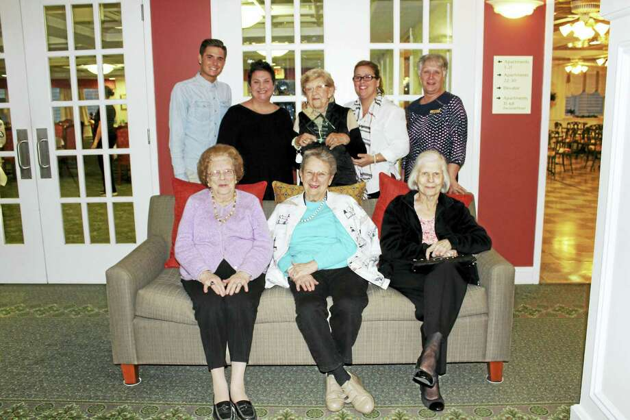 Residents and staff at Crosby Commons, bottom row, from left, Elaine MacQuarrie, Dolly Woerner and Mary Latino; and top rowm from left, Jake DeLucia, Kelly Coppola, Ruth Schless, Executive Director Lori Pisani and Cathy Brelsford. Photo: CONTRIBUTED PHOTO