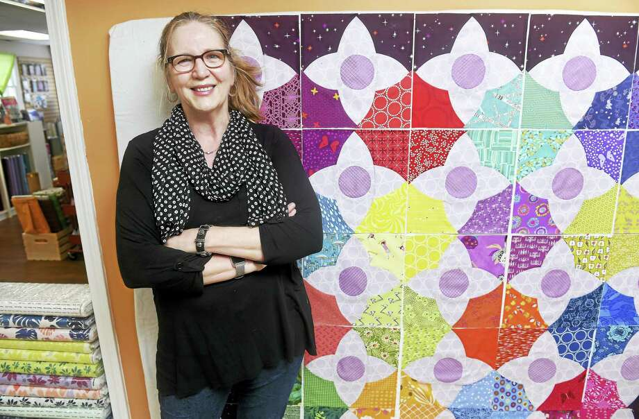 Cate Boeth, owner of Cate's Sew Modern, is photographed next to a design board in her store at 266 Boston Post Road in Madison.  Layed out on the design board is Meadow Quilt by Lizzy House. Photo: Arnold Gold — New Haven Register