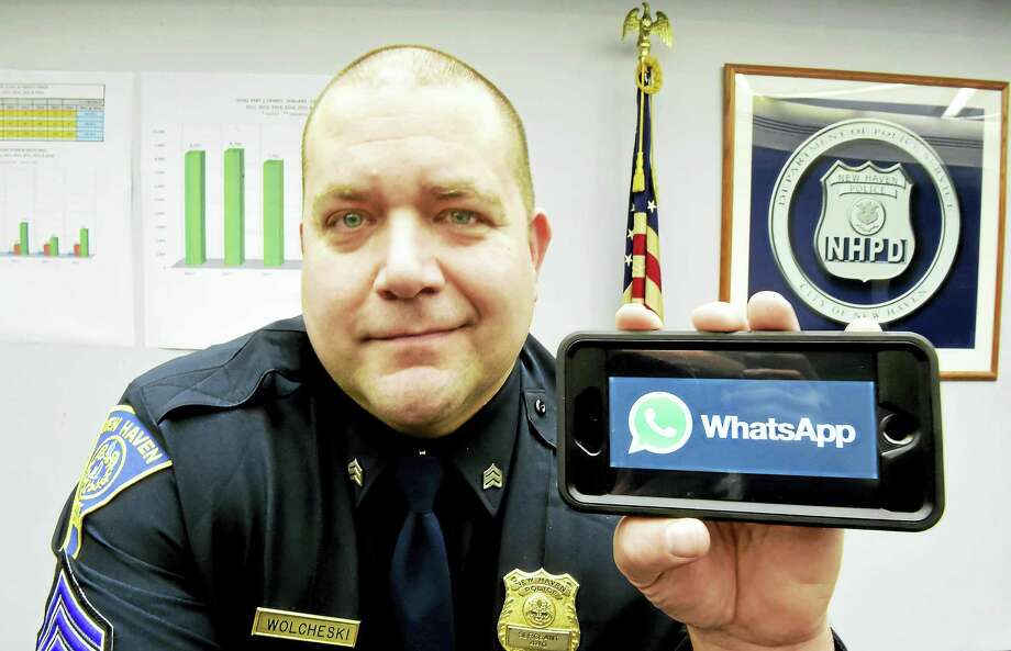 New Haven Police Sgt. John Wolcheski, a district manager in the Whalley / Beaver Hills area, displays the WhatsApp on his smartphone, being used a community policing tool to fight crime. Photo: Peter Hvizdak — New Haven Register   / ©2017 Peter Hvizdak