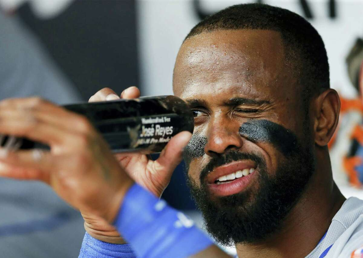 New York Mets' Jose Reyes inspects his bat before a baseball game against the Atlanta Braves Wednesday. Reyes had five RBIs in the 16-5 rout.