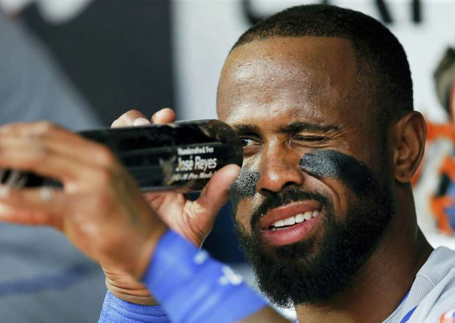 New York Mets' Jose Reyes inspects his bat before a baseball game against the Atlanta Braves Wednesday. Reyes had five RBIs in the 16-5 rout. Photo: JOHN BAZEMORE — THE ASSOCIATED PRESS   / Copyright 2017 The Associated Press. All rights reserved.
