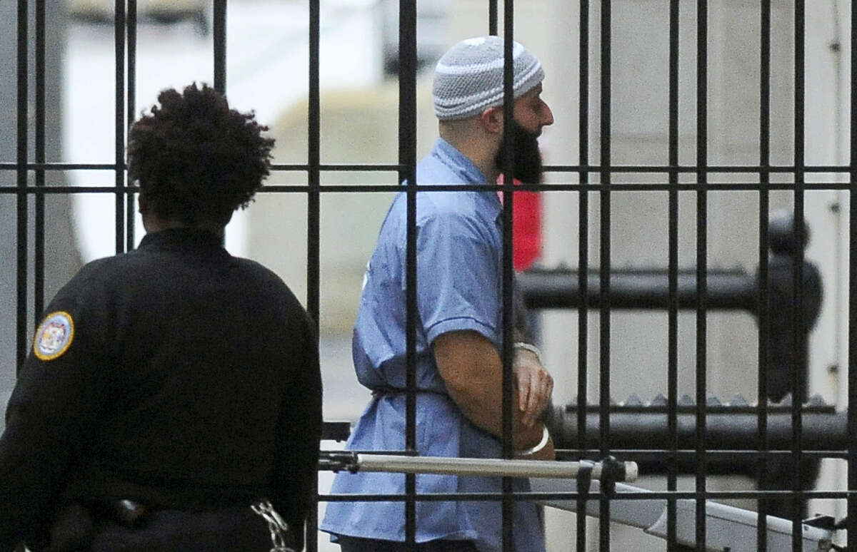 """In this Feb. 3, 2016 file photo, Adnan Syed enters Courthouse East in Baltimore prior to a hearing in Baltimore. Attorneys for Syed, convicted of killing his high school sweetheart, and whose story is at the center of the popular podcast """"Serial,"""" will argue Thursday, June 8, 2017 that he deserves a new trial after his conviction was vacated."""