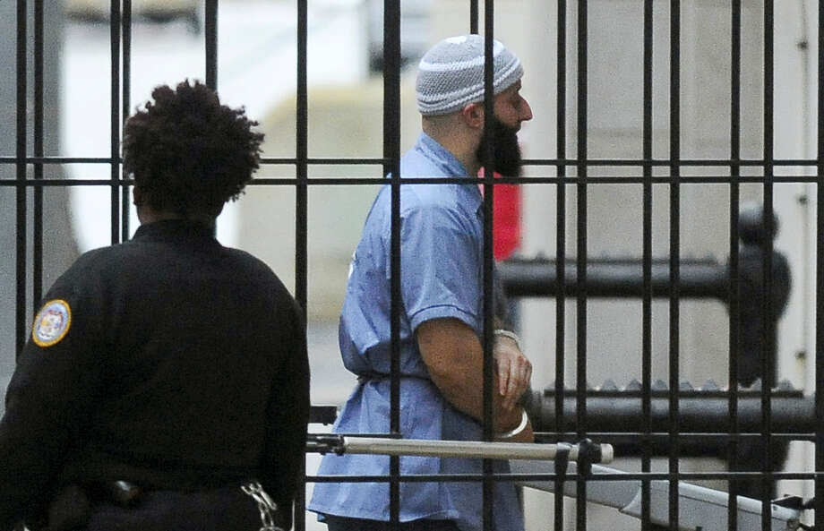 """In this Feb. 3, 2016 file photo, Adnan Syed enters Courthouse East in Baltimore prior to a hearing in Baltimore.   Attorneys for Syed, convicted of killing his high school sweetheart, and whose story is at the center of the popular podcast """"Serial,"""" will argue Thursday, June 8, 2017  that he deserves a new trial after his conviction was vacated. Photo: Barbara Haddock Taylor — The Baltimore Sun Via AP   / The Baltimore Sun"""