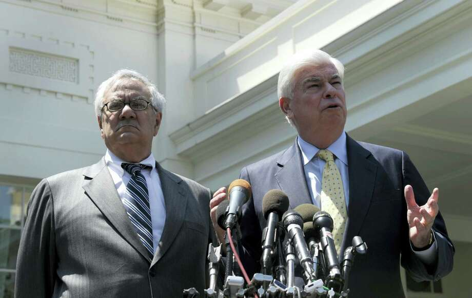 In this May 21, 2010, file photo, then-Senate Banking Committee Chairman Sen. Christopher Dodd, D-Conn., right, and then- House Financial Services Committee Chairman Rep. Barney Frank, D-Mass., speak to reporters outside the White House in Washington, after their meeting with President Barack Obama. House Republicans headed toward a vote June 8, 2017, on dismantling sweeping financial rules established under Obama that were designed to head off economic meltdowns. Republicans are arguing that the many requirements imposed under what is known as the Dodd-Frank Act have actually harmed economic growth by making it harder for consumers and businesses to get credit. Photo: Susan Walsh — AP Photo, File   / AP2010