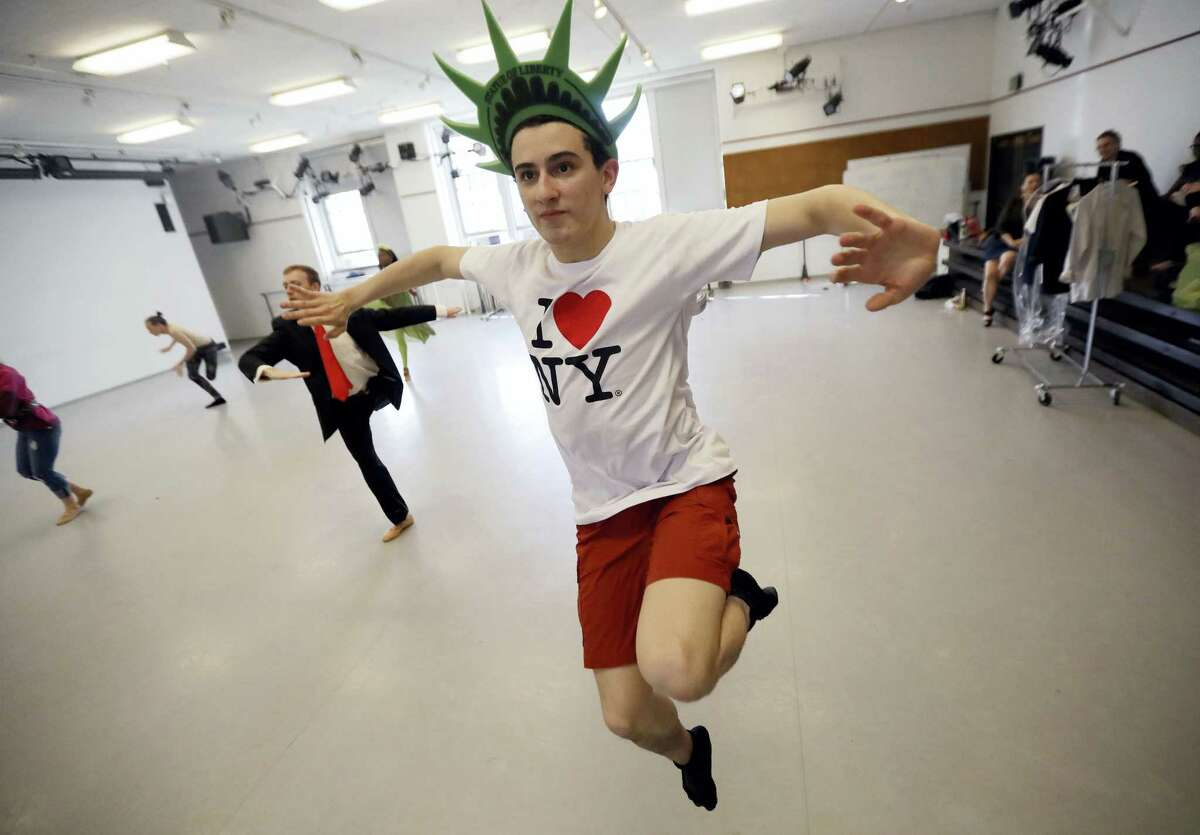 "In this April 28, 2017, photo, William Keiser, a sophomore German studies major at Princeton University, dances with other cast members at a rehearsal for the 1923 Cole Porter ballet, ""Within the Quota"". A group of Princeton University students are remixing the ballet to protest President Donald Trump's immigration policies. The ballet was Porter's response to the immigration restrictions of 1921 which criticized America's hostile stance toward immigrants. The updated version features caricatures including a wealthy heiress, environmentalist, the press, and Black Lives Matter."