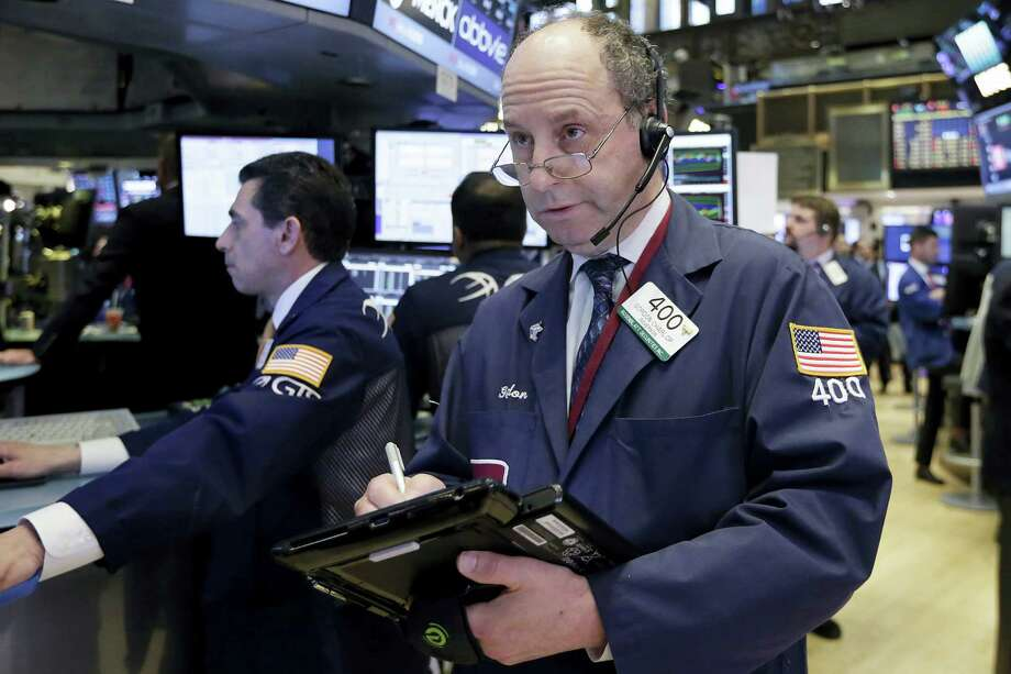 Trader Gordon Charlop works on the floor of the New York Stock Exchange Wednesday. Photo: Richard Drew — The Associated Press   / AP