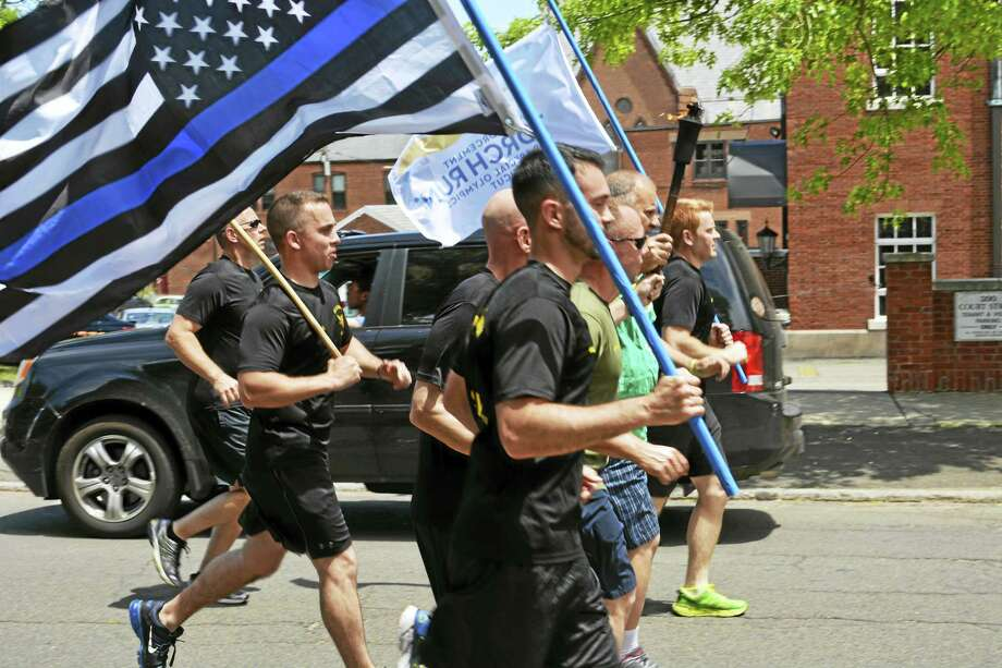 The annual Special Olympics Connecticut Law Enforcement Torch Run arrived in Middletown Thursday afternoon, during the North Branford-to-Hartford leg. Photo: Cassandra Day — The Middletown Press