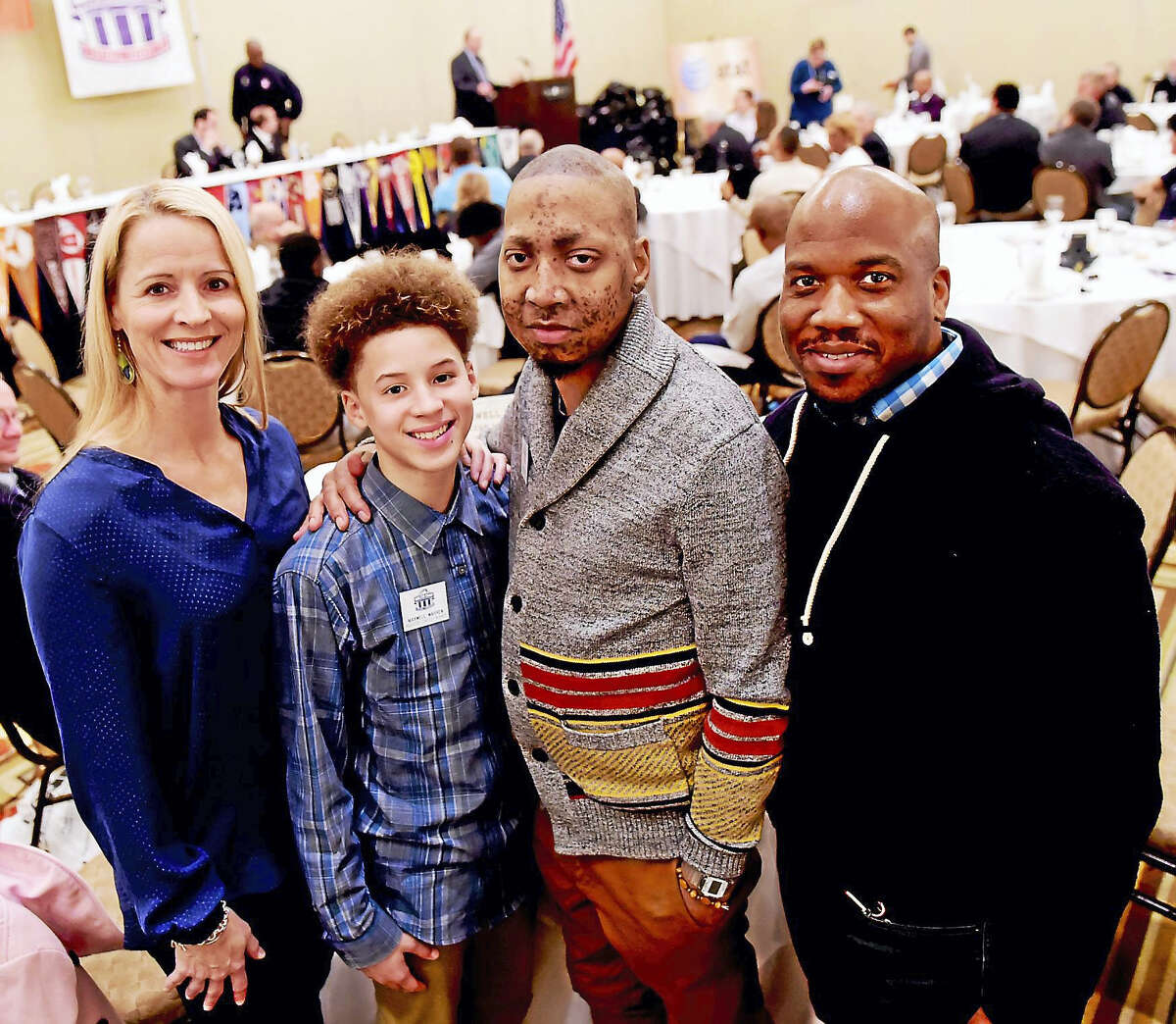 Second from left, Maxwell Warren, 12, of West Haven, is the winner of the New Haven Register Walter Camp Essay Contest. Joining him, from left, are his mother Elizabeth Warren, his uncle Mark Warren of Wolcott and his father David Warren.
