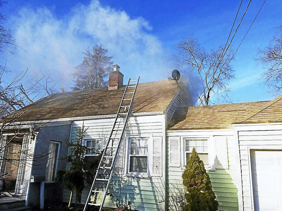 Local firefighters chased down a fire Friday morning in the walls of a home at 28 Lynmot Road in Hamden. No was hurt in the fire, which was first reported in a bathroom fan. Photo: Photo Courtesy Of The Hamden Fire Department