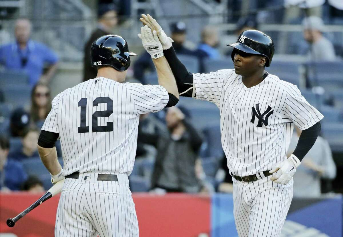 New York Yankees' Didi Gregorius, right, celebrates with Chase Headley (12) after Gregorius hit a home run during the third inning against the Boston Red Sox on Wednesday in New York.