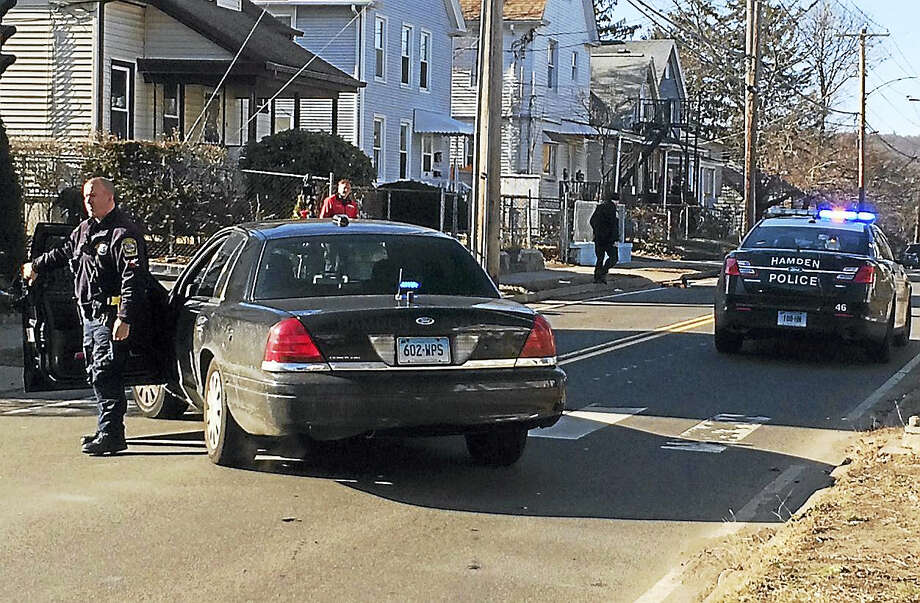Part of Arch Street in Hamden was shut down for a short time Friday morning after a skateboarder was hit by a car. The impact broke the skateboard in half but its rider's injuries were not considered life-threatening. Photo: Wes Duplantier — New Haven Register