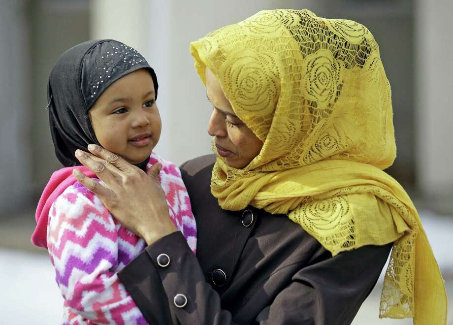 Somali refugee Nimo Hashi holds her daughter Taslim at their home on Jan. 31, 2017 in Salt Lake City. Hashi bought a new kitchen table and couches for her Salt Lake City apartment in joyful anticipation of reuniting Friday with her husband for the first time in nearly three years. But he won't be arriving as planned to see her and the 2-year-old daughter he's never met. He is among hundreds of people stuck in limbo after President Donald Trump's executive order temporarily banned refugees and nearly all travelers from seven Muslim-majority countries, including Somalia. Photo: Rick Bowmer — AP Photo   / Copyright 2017 The Associated Press. All rights reserved.