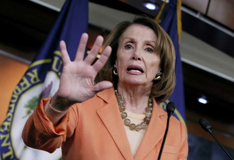 House Minority Leader Nancy Pelosi of California speaks to reporters on Capitol Hill in Washington. Photo: Associated Press — J. Scott Applewhite   / AP