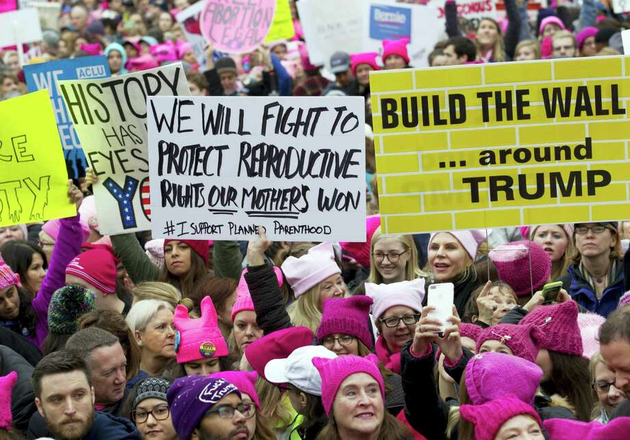 Women with bright pink hats and signs begin to gather early and are set to make their voices heard on the first full day of Donald Trump's presidency, in Washington. The owner of a Tennessee knitting store doesn't want anyone buying its yarn for arts and crafts for the women's movement, following weekend protests by marchers in knitted, pointy-eared hats. The Tennessean newspaper reported that the comments Tuesday on the Facebook page of The Joy of Knitting store in Franklin drew both support and vows of a boycott. Photo: Jose Luis Magana — AP File Photo / FR159526 AP