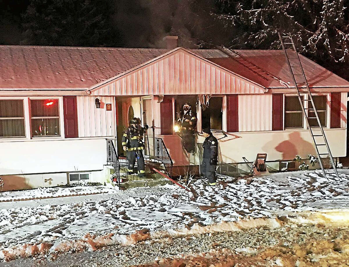 A family of five escaped early Wednesday after a fire broke out at their home in the 500 block of Hartford Turnpike.