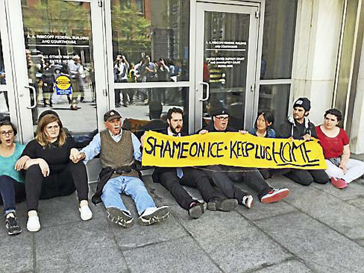 Protesters block the door to the federal building in Hartford.