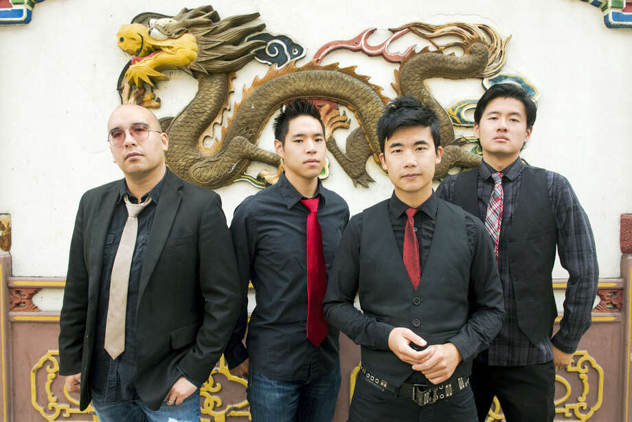 "The Asian-American band The Slants, from left, Joe X Jiang, Ken Shima, Tyler Chen and Simon ""Young"" Tam. Photo: Anthony Pidgeon — Redferns Via The Slants Via AP   / ©Anthony Pidgeon 2015"