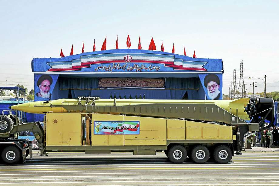 An Emad long-range ballistic surface-to-surface missile is displayed by the Revolutionary Guard during a military parade, in front of the shrine of late revolutionary founder Ayatollah Khomeini, just outside Tehran, Iran. At a joint news conference Tuesday, Jan. 31, 2017, with his visiting French counterpart Jean-Marc Ayrault, Iranian Foreign Minister Mohammad Javad Zarif, refused to confirm that the country conducted a recent missile test, saying Iran's missile program is not part of a 2015 landmark nuclear deal between his country and world powers. Photo: Ebrahim Noroozi — AP File Photo   / Copyright 2016 The Associated Press. All rights reserved.